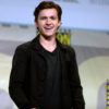 Tom Holland shares how a drunken phone call and a few tears have saved Spiderman amidst the planned Disney-Sony split.