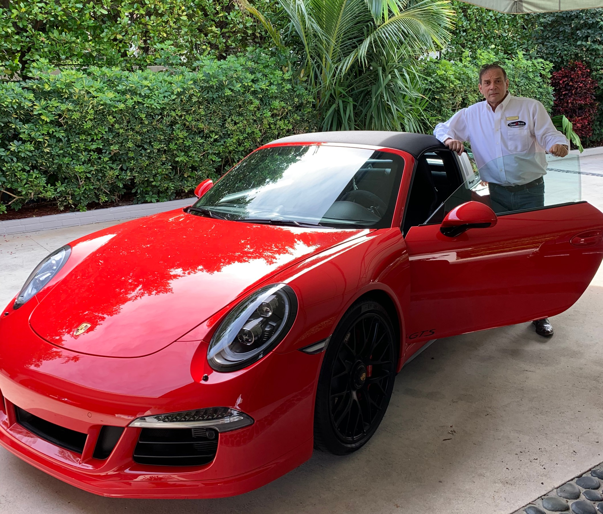 Keith A Gray with his red Porsche 911 GTS