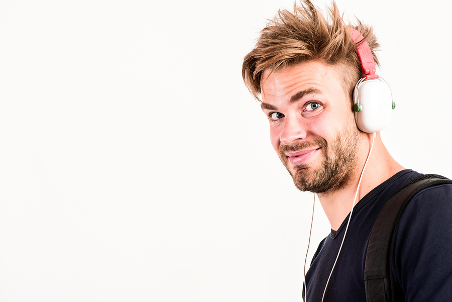 Man wearing his headphones while listening to music.