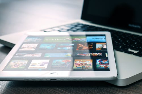 Tablet and laptop showing videos.